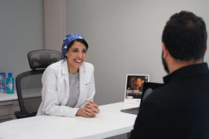 dentist with patient - blossom smiles dental